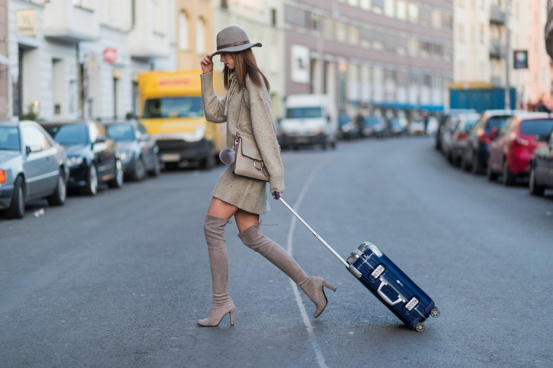 BERLIN, GERMANY - JANUARY 27: Barbora Ondrackova (czech fashion blogger)  with a navy Rimowa suitcase wearing a beige oversized knit Zara, beige Stuart Weitzman overknees a beige Chloe bag, a grey H&M hat on January 27, 2017 in Berlin, Germany. (Photo by Christian Vierig/Getty Images)
